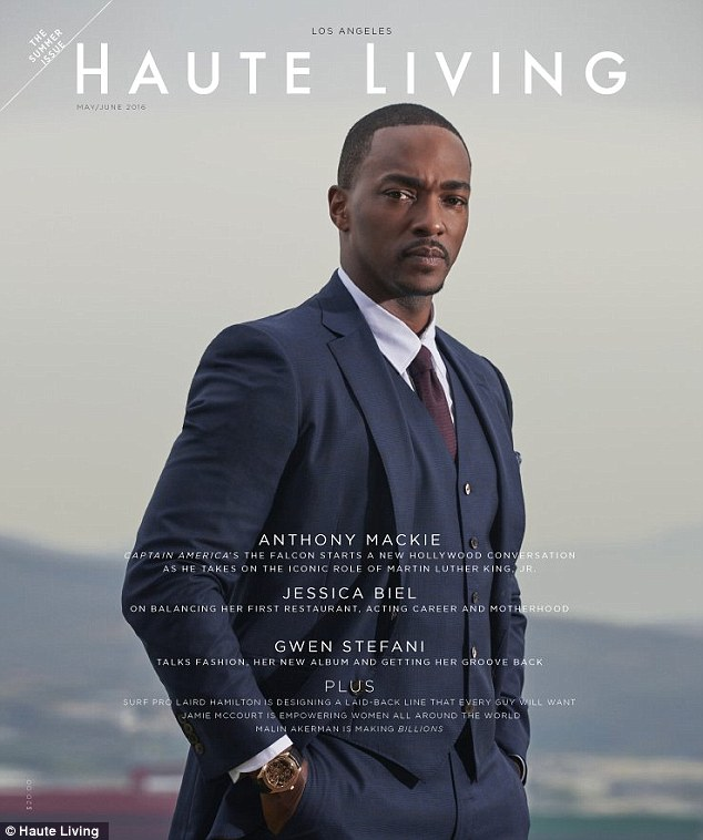 Looking sharp: For the cover, Anthony poses in a navy blue suit with white shirt and burgundy tie