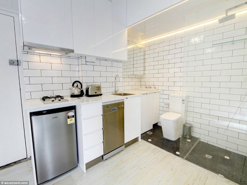 This small Sydney apartment would make for an interesting dinner party when the toilet is adjacent to the kitchen
