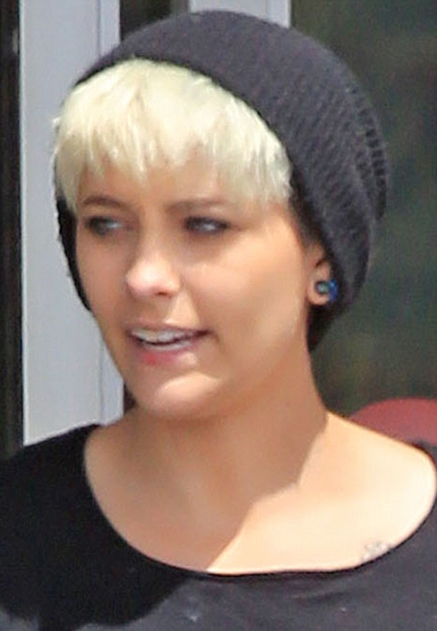 Not Bad: She looked the height ofskater chic thanks to her trendy woollen beanie hat