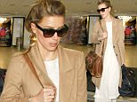 Actress Amber Heard looks chic in a tan coat and a white dress in brown sandals as she arrives at LAX airport in Los Angeles, CA\n\nPictured:  Amber Heard \nRef: SPL1285827  180516  \nPicture by: iPix211/London Ent/Splash News\n\nSplash News and Pictures\nLos Angeles: 310-821-2666\nNew York: 212-619-2666\nLondon: 870-934-2666\nphotodesk@splashnews.com\n