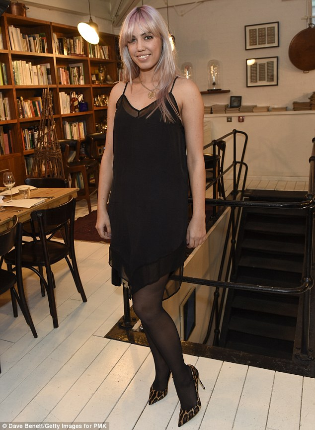 Attention grabbing: Amber Le Bon went for an all black outfit, lifted by her chameleon pink locks and a striking pair of heels