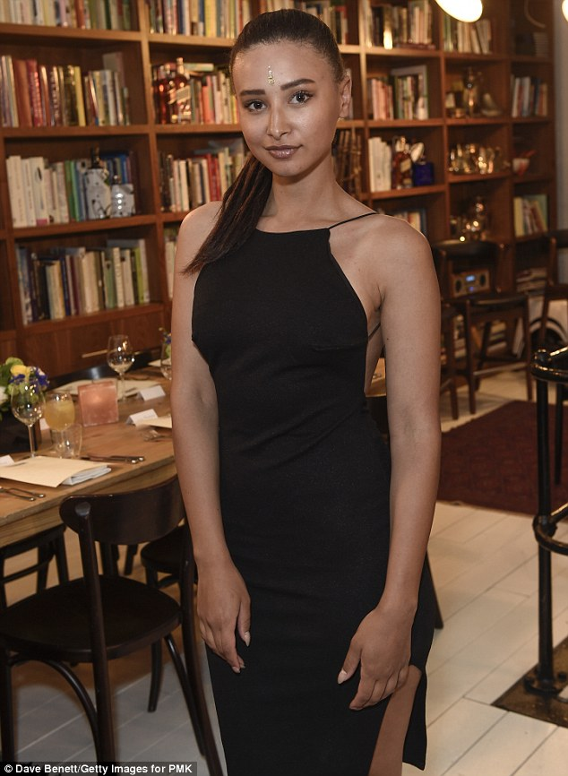 Side split: Leah Weller looked gorgeous in a backless black dress split high on the thigh