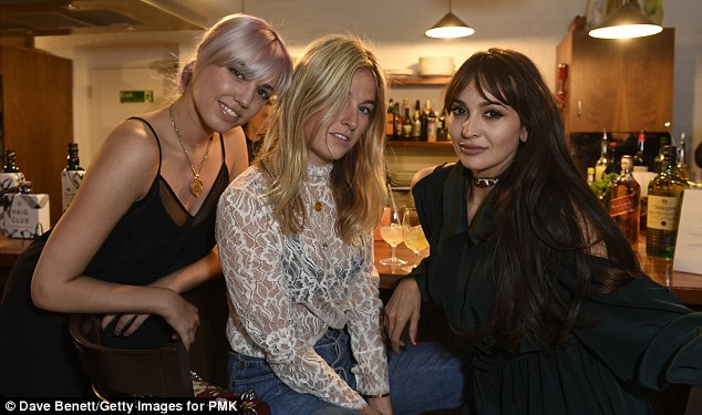 A chunky gold necklace was the only statement jewellery Amber needed, with her long pastel locks injecting an eye-catching burst of colour into the room, pictured with Camille Charriere (C) and Zara Martin (R)