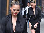 New York, NY - Chrissy Teigen and John Legend leave little Luna with her nanny as the handsome couple step out for the evening dressed to kill in black and blue in New York City. Chrissy held her flowing black dress in place as she held hands with her songwriting man dressed in a blue suit and smile, while walking to their ride outside their New York home together.\nAKM-GSI  May  19, 2016\nTo License These Photos, Please Contact :\nSteve Ginsburg\n(310) 505-8447\n(323) 423-9397\nsteve@akmgsi.com\nsales@akmgsi.com\nor\nMaria Buda\n(917) 242-1505\nmbuda@akmgsi.com\nginsburgspalyinc@gmail.com