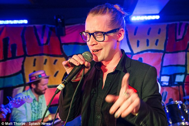 Crowd pleaser: The 35-year-old threw his some of his best moves for the performance and seemed almost dazed with joy as he took to the stage with best pal, Adam Green