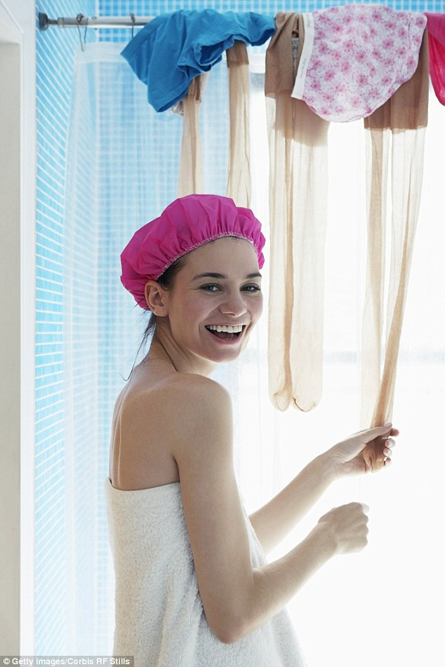 Steamy: Hang your clothes over the shower rack while you wash for a quick steam clean