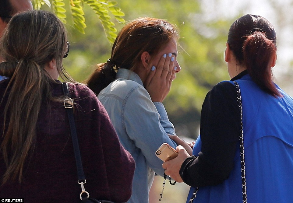 Agony: A woman reacts as she waits outside the EgyptAir service building where relatives are being held at Cairo International Airport