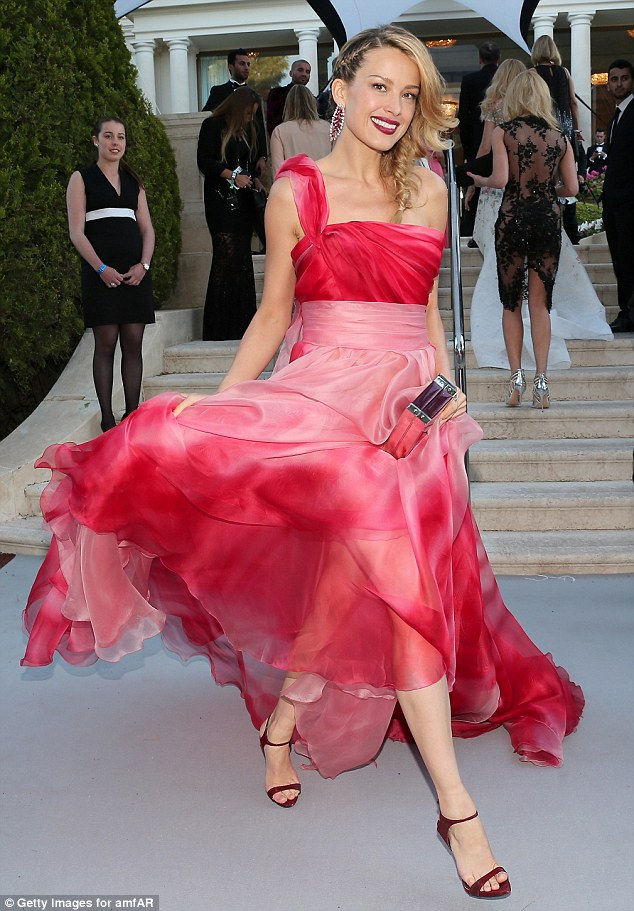 Show-stopping:Petra Nemcova, 36, turned heads in an eye-catching gown at amfAR's 23rd Cinema Against AIDS Gala at Hotel du Cap-Eden-Roc in Cannes, France, on Thursday