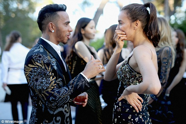 Good times:Seen having a good chat as they spoke on the red carpet, the pair were laughing and joking ahead of the charitable proceedings of amfAR