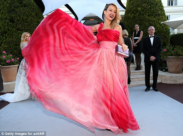 Having a blast! The 36-year-old Czech beauty utilised the extra material of her stunning pink dip-dyed floor-length Georges Chakra gown to create dramatic movement