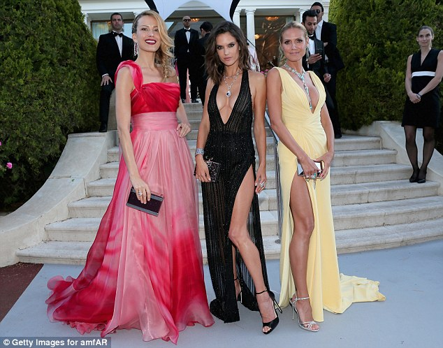 Supermodel squad goals: Alessandra Ambrosio (Centre) and Heidi Klum (R) opted for demure in a similar dresses which featured thigh high splits and plunging necklines, but in different shades
