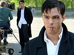 Actor Nicholas Hoult, sporting bruises and a black eye, films 'The Rebel in the Rye' in Central Park in New York City on May 19, 2016. Nicholas chats with director Danny Strong between takes. Nicholas films a scene where he comes upon a group of Transcendentalists meditating. \n\nPictured: Nicholas Hoult\nRef: SPL1286615  190516  \nPicture by: Christopher Peterson/Splash News\n\nSplash News and Pictures\nLos Angeles: 310-821-2666\nNew York: 212-619-2666\nLondon: 870-934-2666\nphotodesk@splashnews.com\n