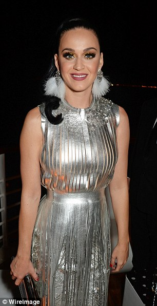 Head-turners: Katy Perry (L) and Lily Donaldson (R) looked stunning in shimmery numbers at the gala