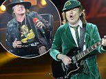 Australian rock band AC/DC's guitarist Angus Young (L) and US singer Axl Rose  perform on stage in Vienna, Austria, on May 19, 2016. / AFP PHOTO / APA / HANS KLAUS TECHT / Austria OUTHANS KLAUS TECHT/AFP/Getty Images