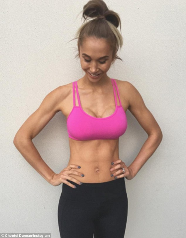 Just like before: She also posed in a bright pink sports crop, showing off her toned physique to her 534,000 followers after she had given birth