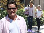 EXCLUSIVE: May 17th 2016 Exclusive \nCharlie Sheen out in Malibu California with Denise Richards & kids. Charlie posed for the camera & threw up peace sign. Charlie had a bandage around his hand. \n\nPictured: Charlie Sheen & Denise Richards\nRef: SPL1282469  170516   EXCLUSIVE\nPicture by: Ability Films / Splash News\n\nSplash News and Pictures\nLos Angeles: 310-821-2666\nNew York: 212-619-2666\nLondon: 870-934-2666\nphotodesk@splashnews.com\n
