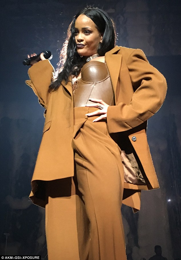 Working hard: Rihanna, 28, has been touring North America relentlessly performing to thousands night after night, so it's no surprise she was ready to soak up some sunshine
