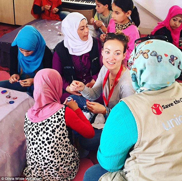 Doing her bit: Olivia recently visited Syrian refugees in Amman and the brunette beauty had some things to say to the wannabe President in an Instagram picture on Tuesday