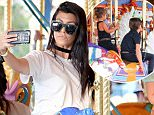 Kourtney Kardashian takes a selfie with her daughter Penelope while on a carousel ride at Disneyland. Little penelope also took a piggie back ride on her mom after their ride as they made their way to dinner. Kourtney was seen spending time with Kim at the happiest place on earth  Pictured: Kourtney Kardashian and Penelope Disick Ref: SPL1286195  190516   Picture by: Fern /Splash News  Splash News and Pictures Los Angeles: 310-821-2666 New York: 212-619-2666 London: 870-934-2666 photodesk@splashnews.com