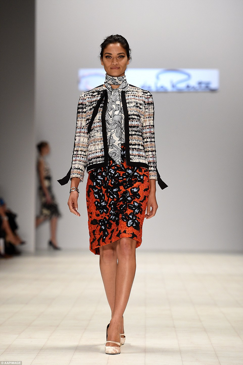 Here she comes: Supermodel Shanina Shaik stunned on the catwalk for Oscar de la Renta in an orange printed skirt and patterned jacket