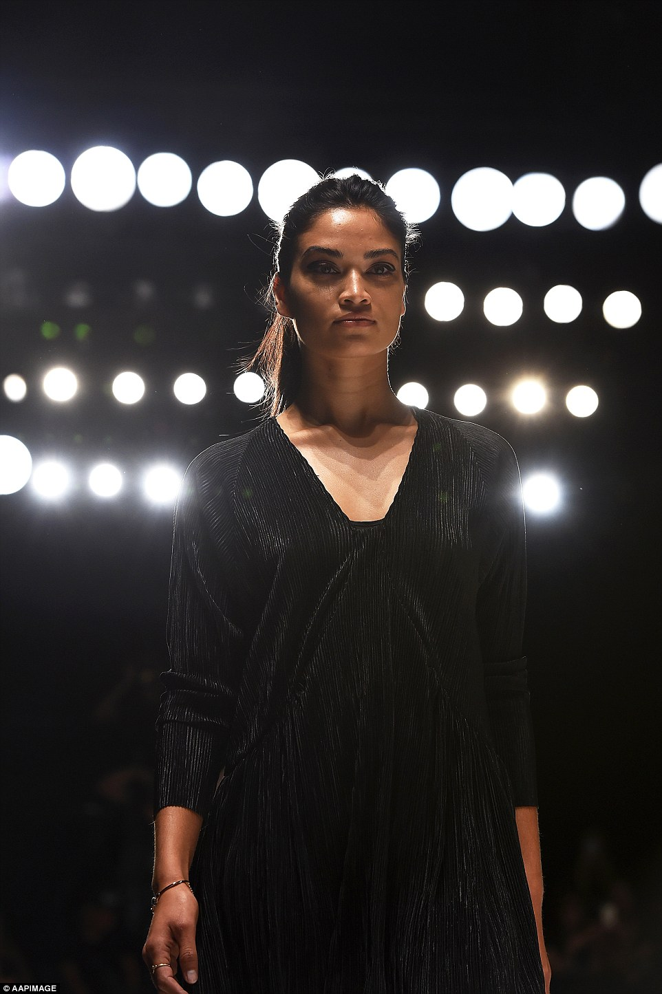 Getting ready: Shanina walked the runway in the same black dress she was photographed in earlier in the day for rehearsals