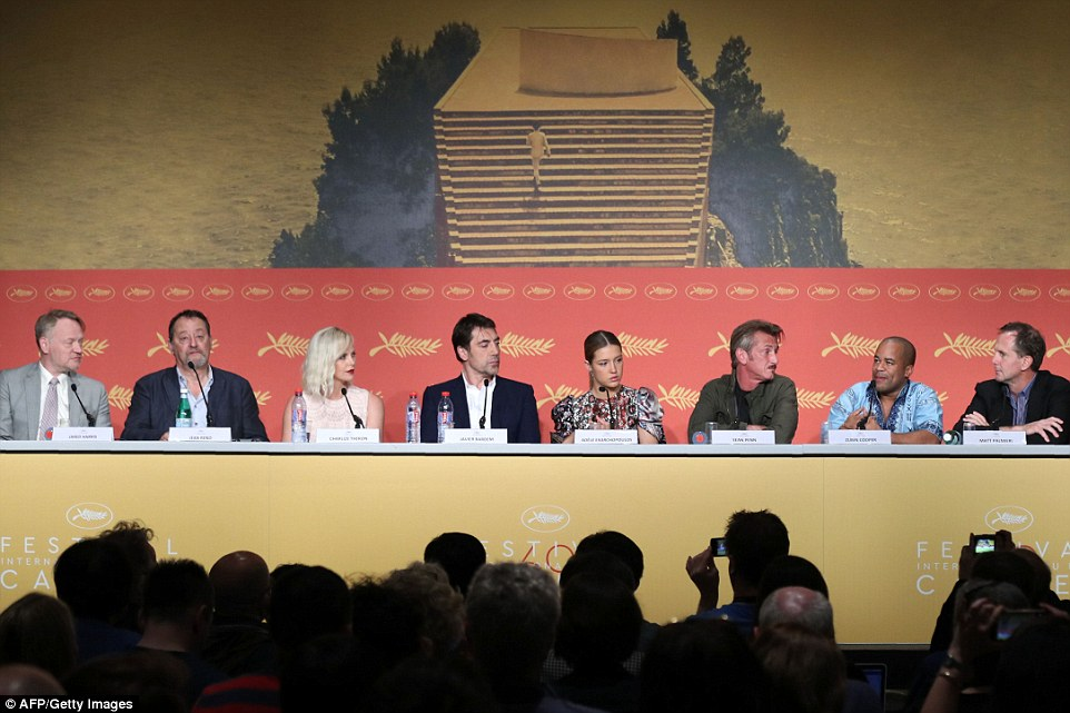 Later on that day: Even at the press conference, the duo were not sat together, and the line-up appeared exactly as it had done on the sea front earlier on