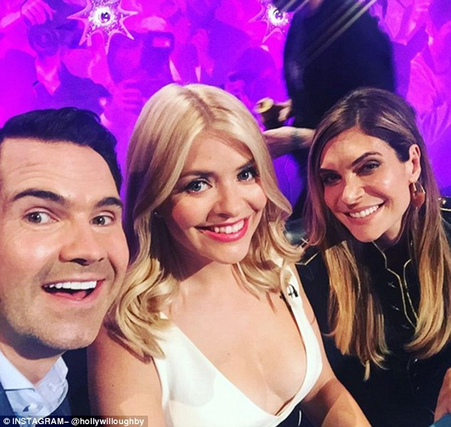 'My gorgeous team!'- Holly has been busy filming for Celebrity Juice and took to Instagram to pose alongside Jimmy Carr and Ayda Field
