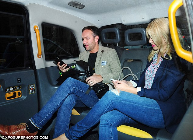Jump in a cab: While Holly went bright and floral in a pink and blue patterned shirt and navy blazer, Dan, 40, went for a heavier wool jacket with a dapper checkered handkerchief his top pocket