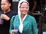 EXCLUSIVE: Christina Milian grabs a smoothie after Soul Cycle class in Los Angeles, California. The pop princess visited Earth Bar to pick up a purple beverage after her workout. Wearing all green gym clothes, white trainers and clear rimmed glasses, the star covered her hair with a headscarf. Yesterday she was seen arriving at LAX airport with a new short hairdo, but kept the new look under wraps today.   Pictured: Christina Milian Ref: SPL1286112  190516   EXCLUSIVE Picture by: Splash News  Splash News and Pictures Los Angeles: 310-821-2666 New York: 212-619-2666 London: 870-934-2666 photodesk@splashnews.com