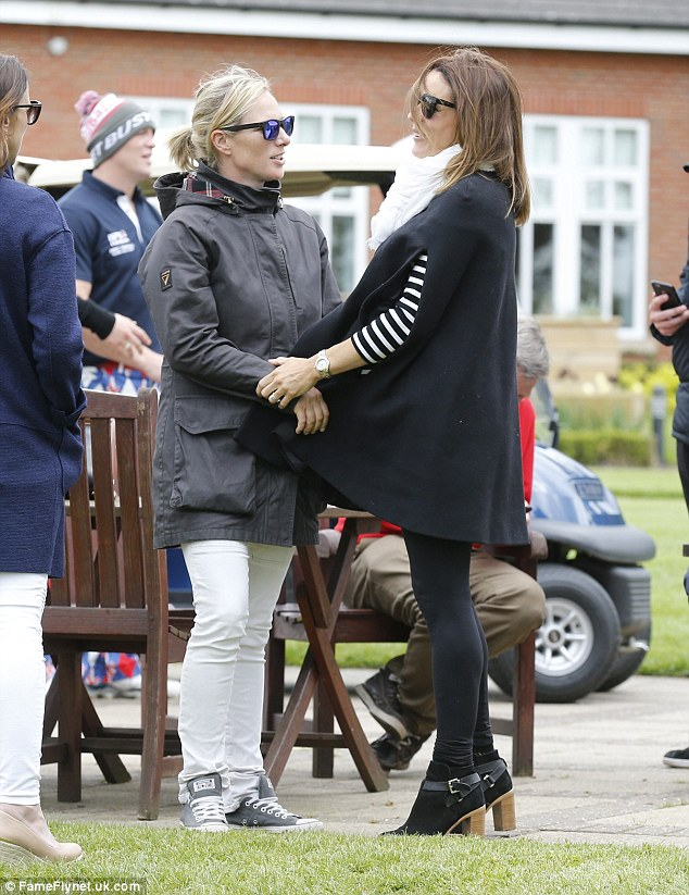Zara Tindall (pictured with Natalie Pinkham, right)  seemed more interested in having a good chin wag with her friends than watching her husband's golf tournament at Sutton Colfield's Belfry today