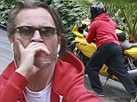 Exclusive... 52064213 Joaquin Phoenix was seen stranded on the side of the rode with a broken down yellow motorcycle in Beverly Hills, California on May 19, 2016. Joaquin sat on the curb and enjoyed a smoke while he waited for the tow truck to come and pick him and his bike up. ***NO WEB USE W/O PRIOR AGREEMENT - CALL FOR PRICING*** FameFlynet, Inc - Beverly Hills, CA, USA - +1 (310) 505-9876