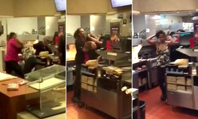Brawl erupts behind the counter at McDonalds as two female employees 'fight over who has