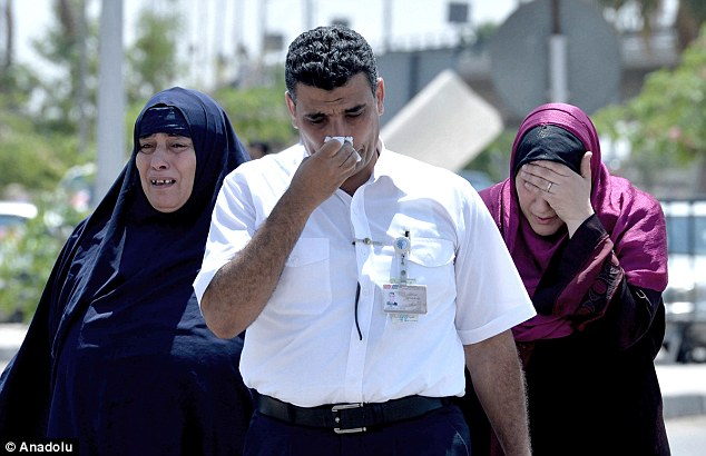 Loss: Relatives of passengers on board the EgyptAir flight cry at Cairo Airport as they try to receive information on their loved ones
