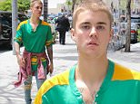 Beverly Hills, CA - Justin Bieber emerges from a blacked out limo SUV in a baggy T-shirt and distressed jeans for a sushi lunch at Sugarfish in Beverly Hills.\nAKM-GSI    May  20, 2016\nTo License These Photos, Please Contact :\nSteve Ginsburg\n(310) 505-8447\n(323) 423-9397\nsteve@akmgsi.com\nsales@akmgsi.com\nor\nMaria Buda\n(917) 242-1505\nmbuda@akmgsi.com\nginsburgspalyinc@gmail.com