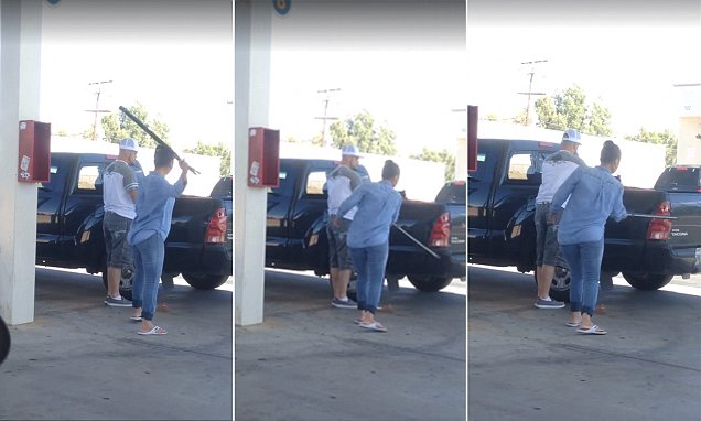 'I told you to move!' Female gas station attendant smashes up customer's truck with a bat
