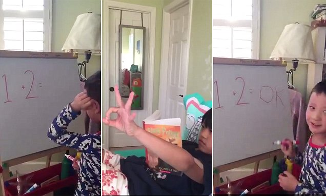 '1 + 2 = OK?' Hilarious moment perplexed five-year-old turns to his big sister for help