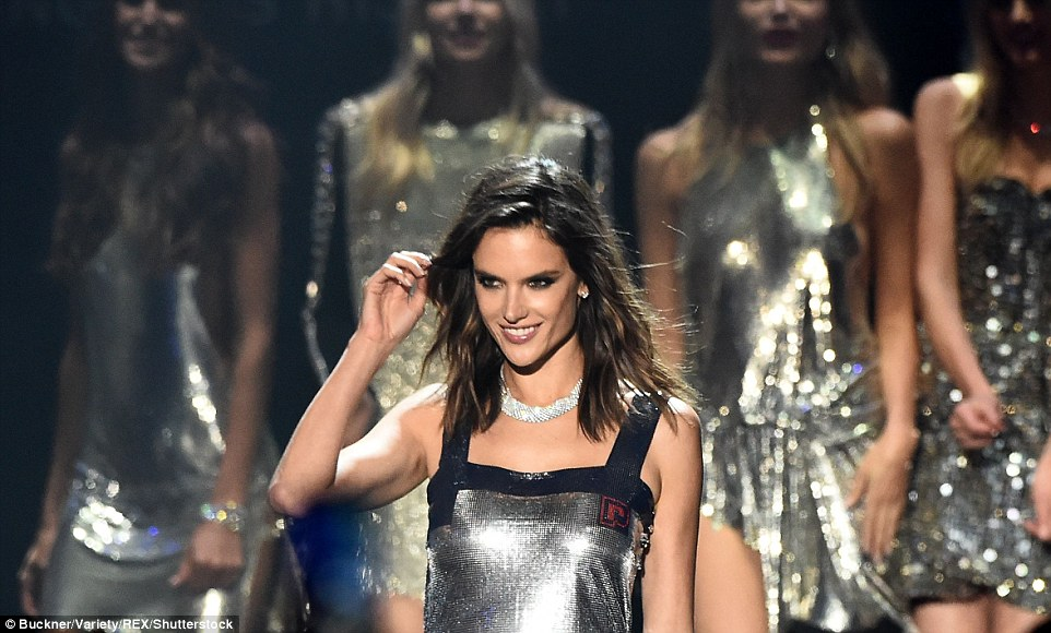 Look at her go:Alessandra changed from her risque black gown with its thigh high split and plunging neckline to slip into a dazzling silver number with a boxy neckline
