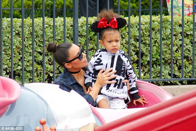 Aww: The wife of Kanye West hopped on the Dumbo ride with their daughter North