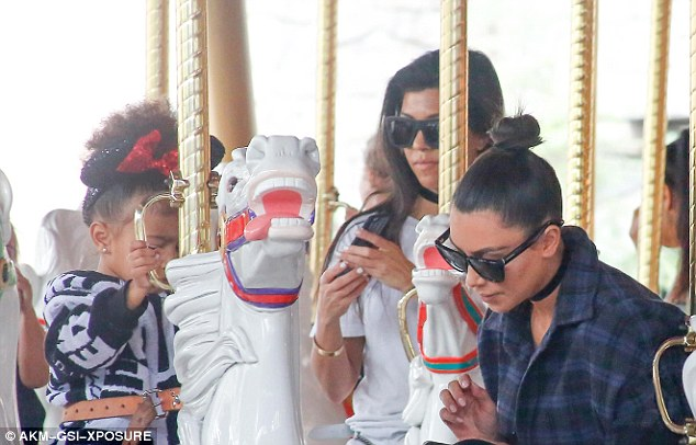 Time to check our phones!The trio were joined by Kim Kardashian and North West, who turns three in June