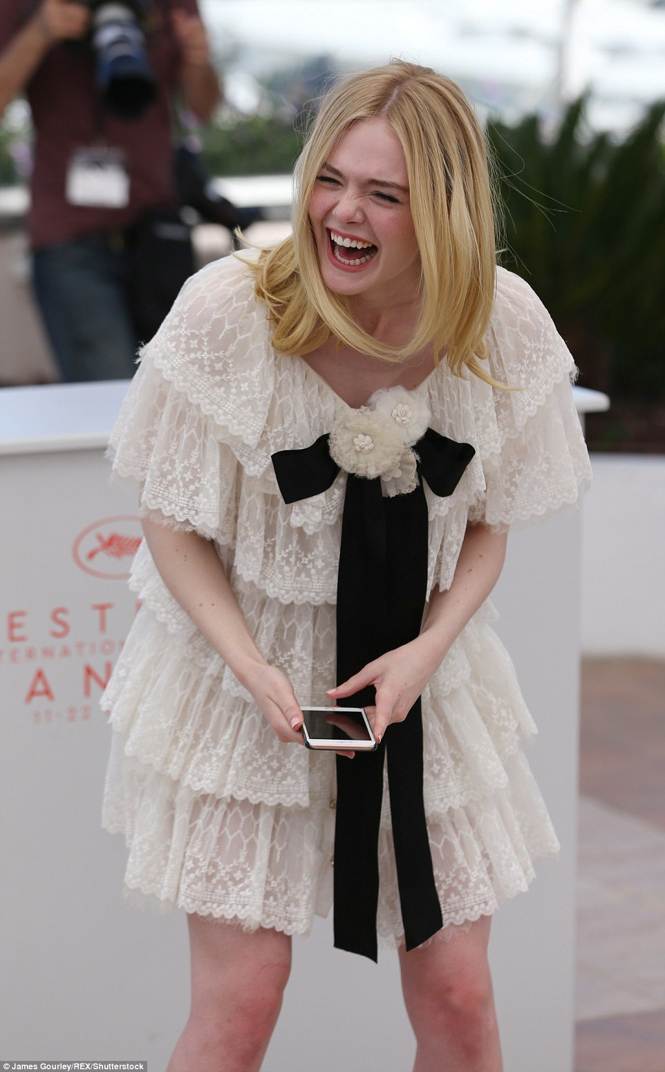 Getting the giggles: The 18-year-old actress was in high spirits as she helped promote the horror film, in which she plays a seemingly innocent aspiring model