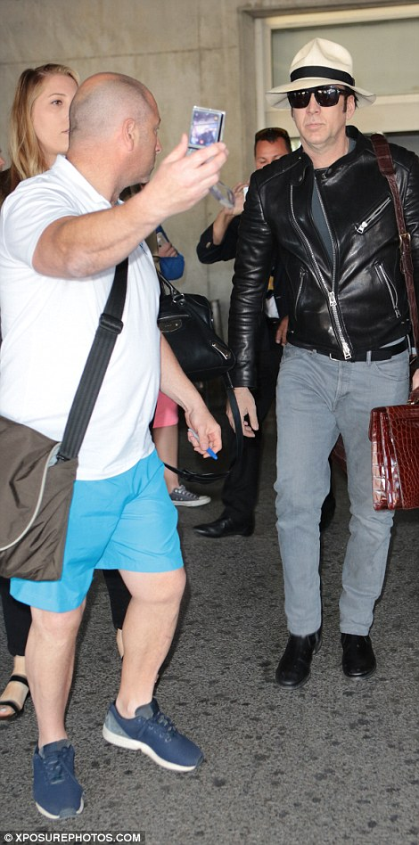 Snap happy: The actor was mobbed by excited fans as he made his way out of Nice airport