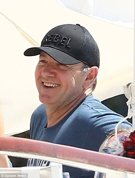 Slogan cap: The American Beauty star protected his eyes from the sun with a 'Rebel' baseball cap