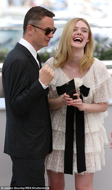 Main man: Elle posed alongside the film's directorNicolas Winding Refn, whose new project has divided critics at Cannes