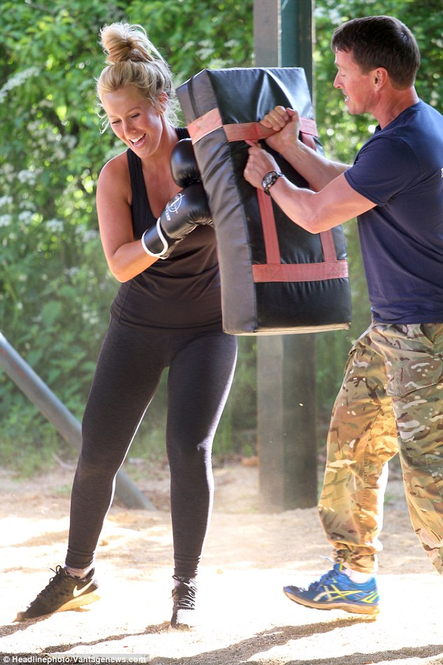 Keeping a tight grip! The bootcamp trained held on to the punching bag tightly as Kate carried out her exercises