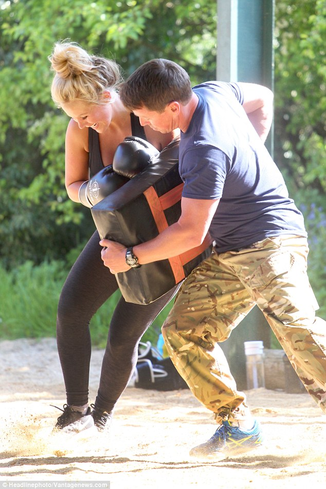Fighting spirit: Kate looked determined to get the better of her muscular trainer
