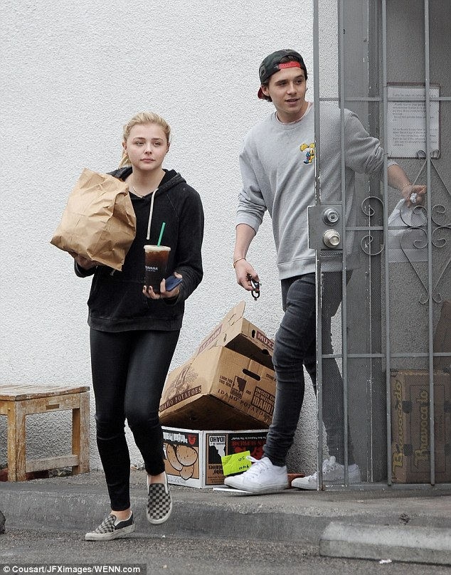 Confession: Chloe Grace Moretz has admitted she has been dating Brooklyn Beckham 'off and on for a couple of years' shortly before they headed out shopping together in Los Angeles on Friday