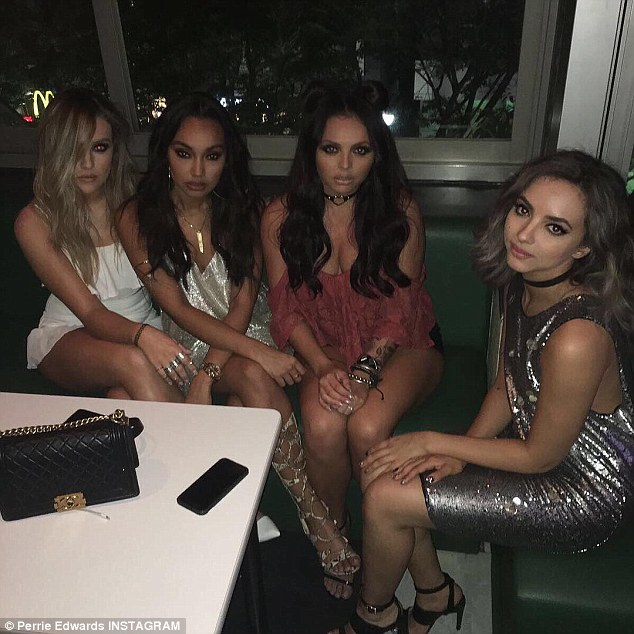 'Lads on tour!': The former fiancé of Zayn Malik also shared a very sultry snap of herself and her girls, who all looked incredible in their disco wear