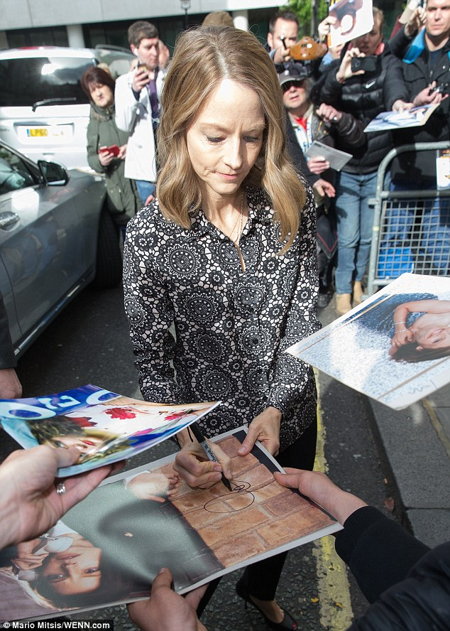Taking her time: The popular actress was happy to sign as many posters as possible