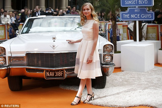 Co-ordinated: Angourie posed with her hand on the bonnet of the classic American car, her choice of outfit perfect for the colour-scheme on display