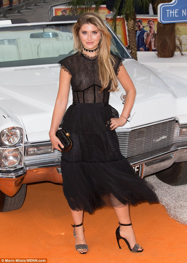 Hot! Lauren Hutton opted for a gothic-tinged ensemble with a semi-sheer top, choker and a ruffled skirt